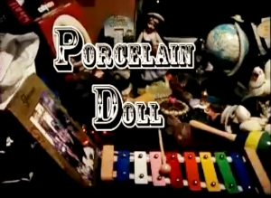 porcelain doll still from video